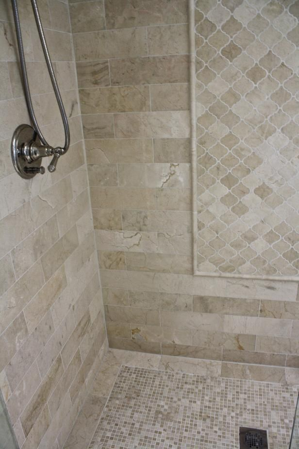 Bring dynamic visual interest to a shower or bathroom by playing with the shape of the tiles. Get inspired by this shower, featured at HGTV.com.