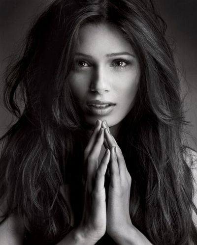 Frida Pinto. This woman is amazingly beautiful. She may have even taken over Angelina Jolie as my girl crush. ;)
