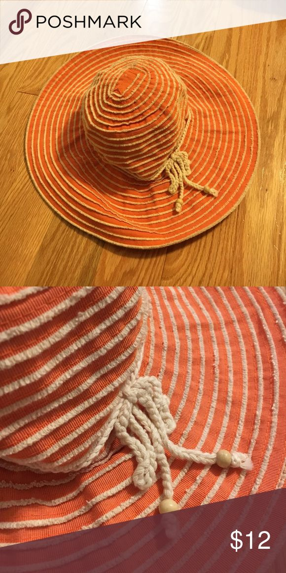 Beach hat Floppy orange hat with cream colored stitching and string detail. Worn once. Accessories Hats