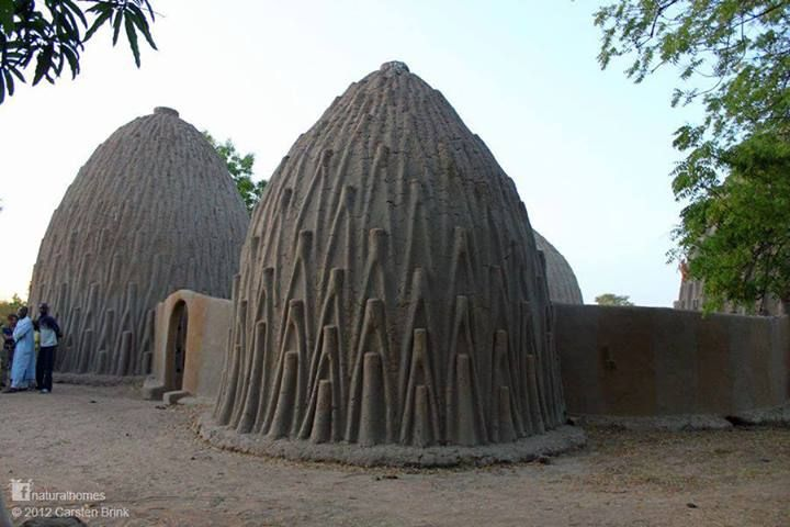 They are built by the Musgum people of the Cameroon. They provide efficient cooling in the baking heat with a round ventilation hole at the top and a small entrance with no windows. The high dome collects the hot air moving it away from the living space. The decorative patterns on the exterior of the obos are in fact a series of steps to allow the community to re-plaster the exterior of the dome