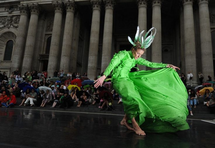 A dancer from the Rambert Dance Company performs in front of St. Paul's Cathedral in central London, as part of the City of London Festival.