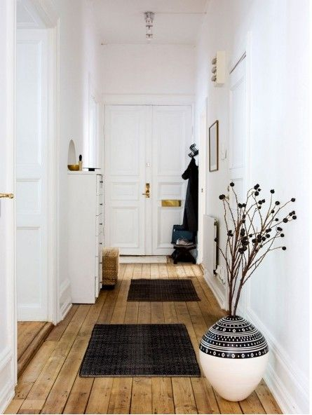 natural floor + black and white + gold hardware + rugs + two tone sgraffito ceramic vase