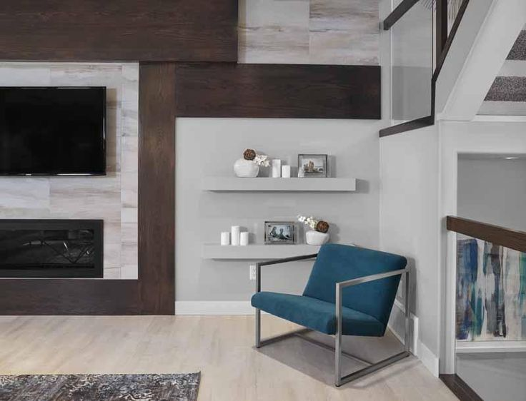 Stone and wood surround this linear gas fireplace. #greatroom #interiordesign #fireplace #livingroom #yegre #customhome #newhome #buildwithkimberley #kimberleyhomes