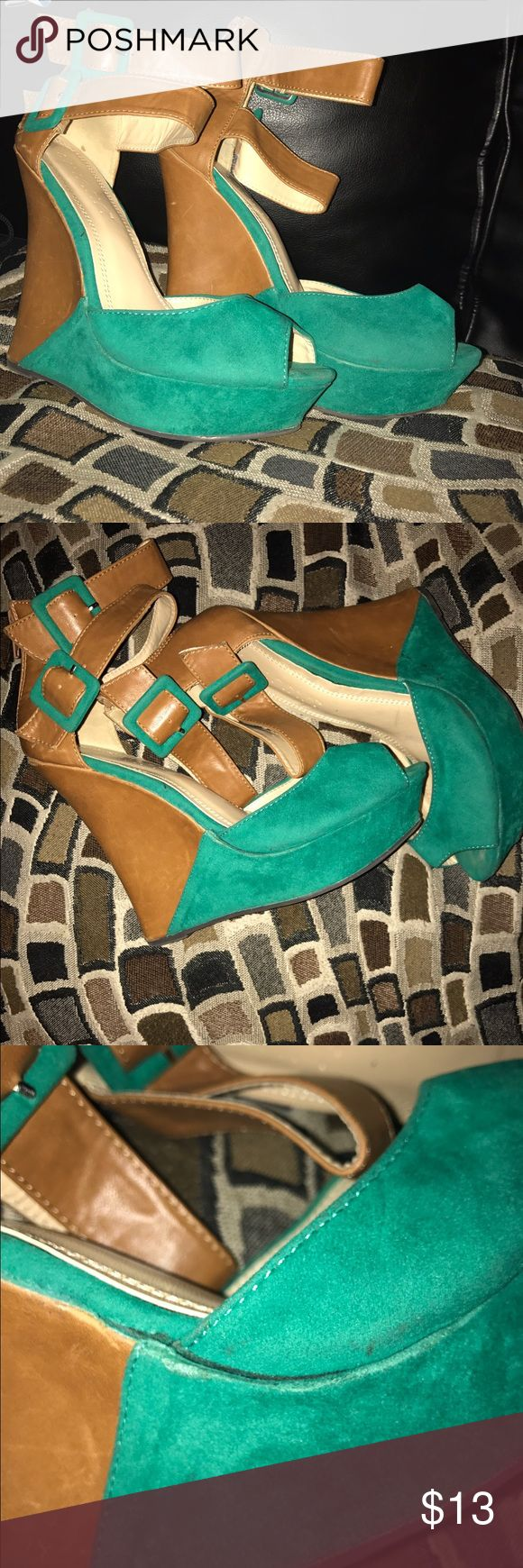 Tan and Green Wedges A cute Flirty wedge that is comfortable to wear. It's got a minor flaw,  noted in the last picture. Nothing that cant be repairer by a little shoe glue. Overall great shoe! Shoes Wedges