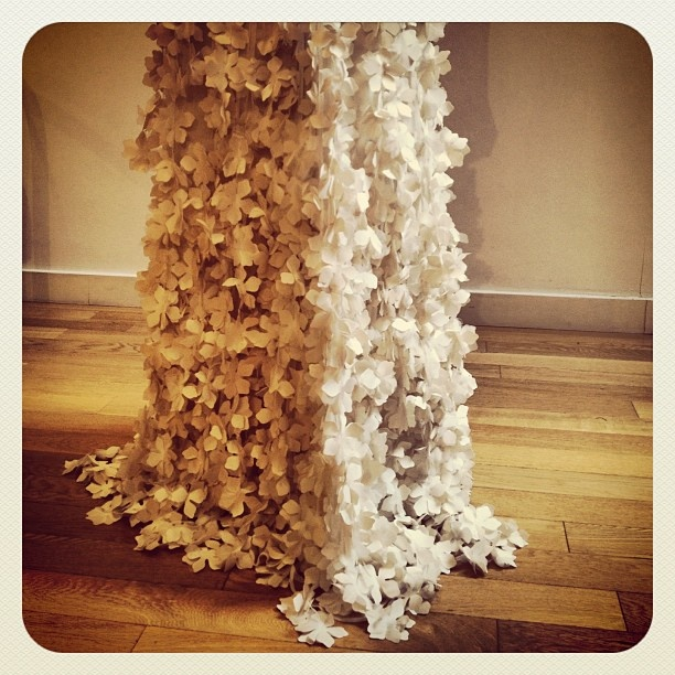 3D flowers dripping from this dress at Cocoe Voci