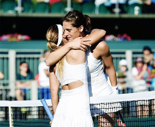 Dominika Cibulkova and Andrea Petkovic embrace at the net after  their women's singles first round match at the 2017 Wimbledon Championships on July 3, 2017.