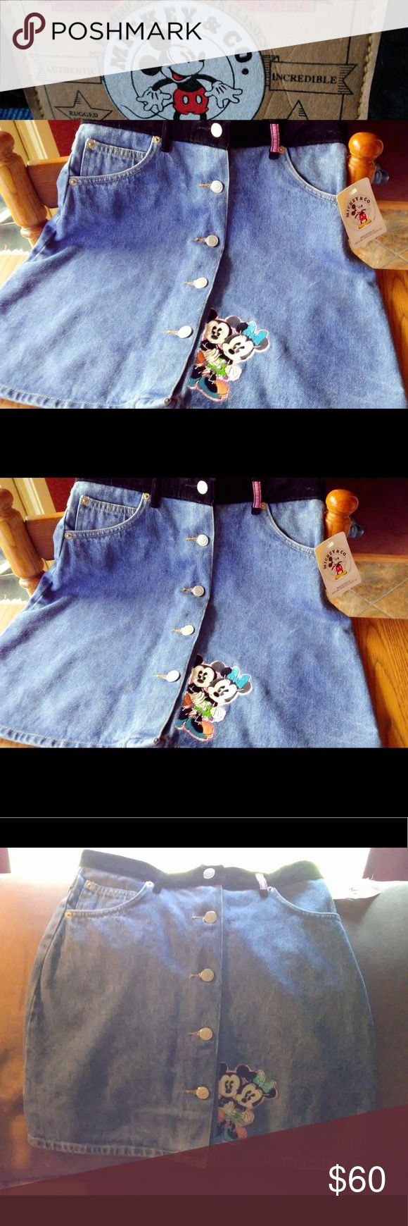 """Mickey Mouse button up Denim 90s Jean skirt 💕 Mickey & Minnie Denim with Velvet black band super cute button up jean skirt vintage from the 90s new with tags 💕💕💕😍😭tag says 16, measures 28"""" so could fit a 25-28"""" waist ✨ high waisted ✨ so amazing! Buy this skirt before it's gone all you Disney babes ❤️⭐️ Mickey & Minnie patch Embroidered Jean Denim skirt ✨ unif kawaii vintage 90s doll skill nastygal Brandy Melville cartoons Minnie Mouse Mickey Mouse patch 2000 Velvet button up skirt…"""