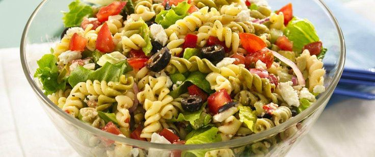 Feta, olives and tomatoes give a ready-in-30-minutes pasta salad its classic Greek inspiration.