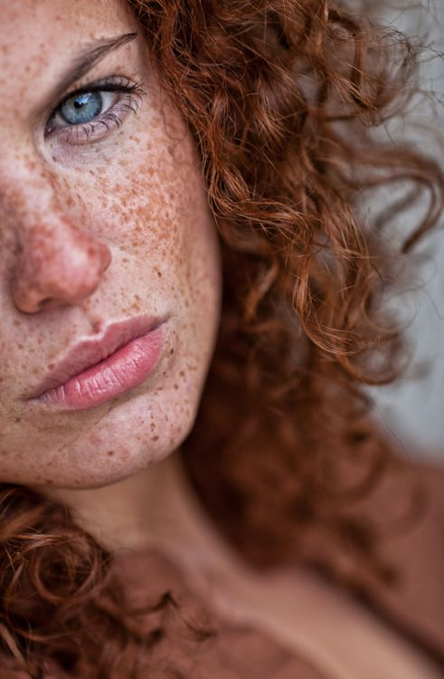 Ahh curly red head with lots of face polka dots and blue eyes. What I should have been born as.