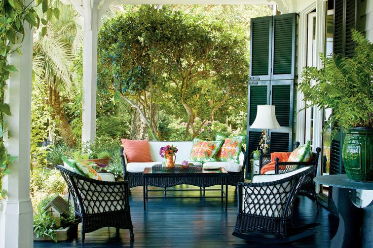 Charming Southern Front Porch - 80 Breezy Porches and Patios - Southernliving. Designer Muffie Faith of Elizabeth Stuart Design, Charleston, SC, created this front porch with a little Southern charm in addition to paint, wicker, and florals. This gracious and inviting porch welcomes company in.  See more of this Charming Southern Front Porch