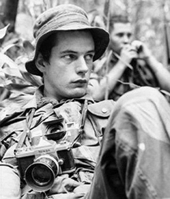 "Tim Page (b 1944) English author and self-taught photographer in Vietnam and Cambodia during the 1960s. In ""Dispatches"", Michael Herr wrote that he was the most 'extravagant' of the 'wigged-out crazies""and his unusual personality was part inspiration for the character of the photojournalist in ""Apocalypse Now"". He was wounded with shrapnel 4 times. Now a lecturer and author including ""Requiem"" a tribute to journalists and photographer who have died in combat zones"