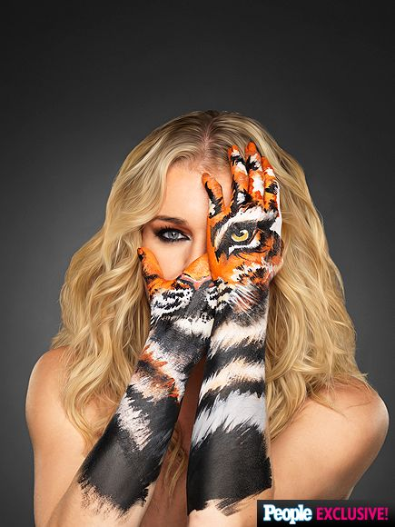 Rebecca Romijn Previews Skin Wars Season 2 with Super Sexy Tigress Teaser http://www.people.com/article/rebecca-romijn-skin-wars-gsn-season-2-exclusive