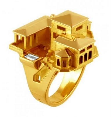 """For the person who has everything.  Florida dream home ring in yellow gold, set with a rectangular aquamarine """"swimming pool"""""""