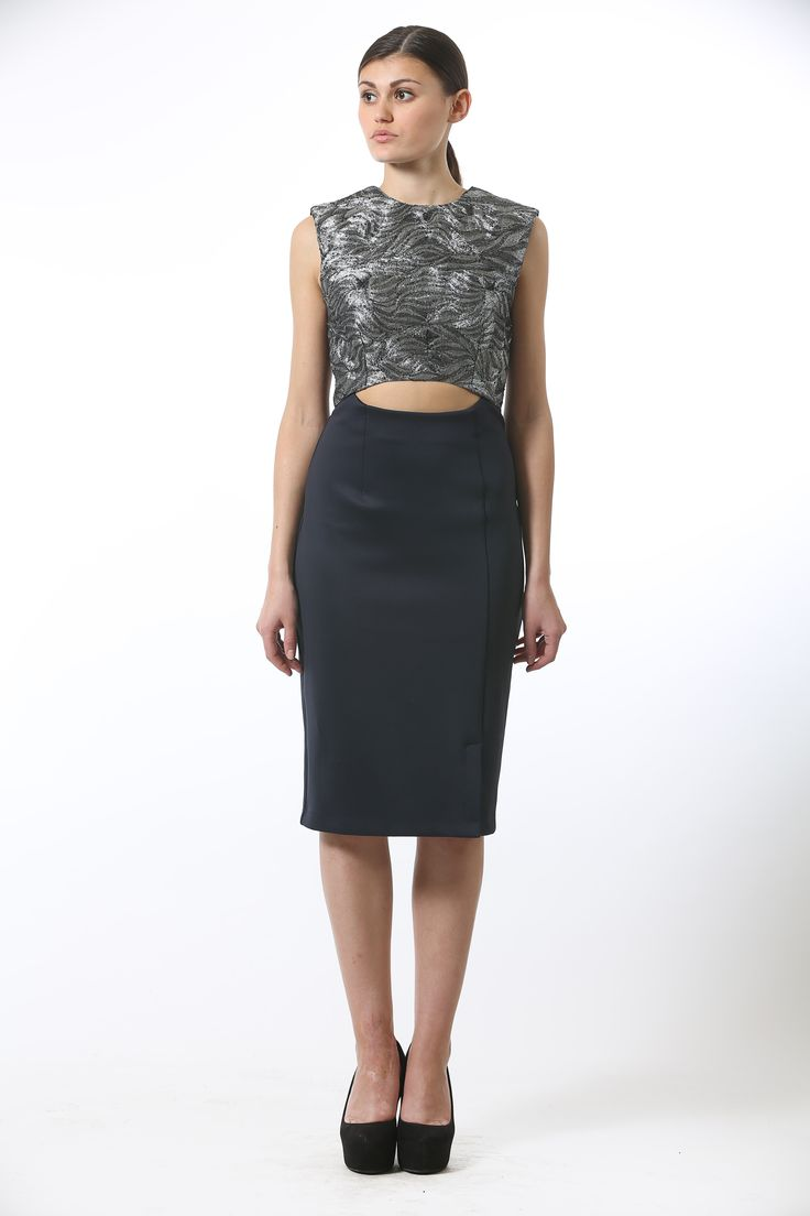 Lycra jersey dress featuring silver embroidered front panel with a cut-out detail and an off center conceal zip bone detail.