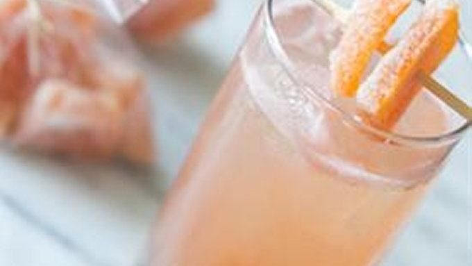 A grapefruit cocktail made with homemade candied grapefruit peels.