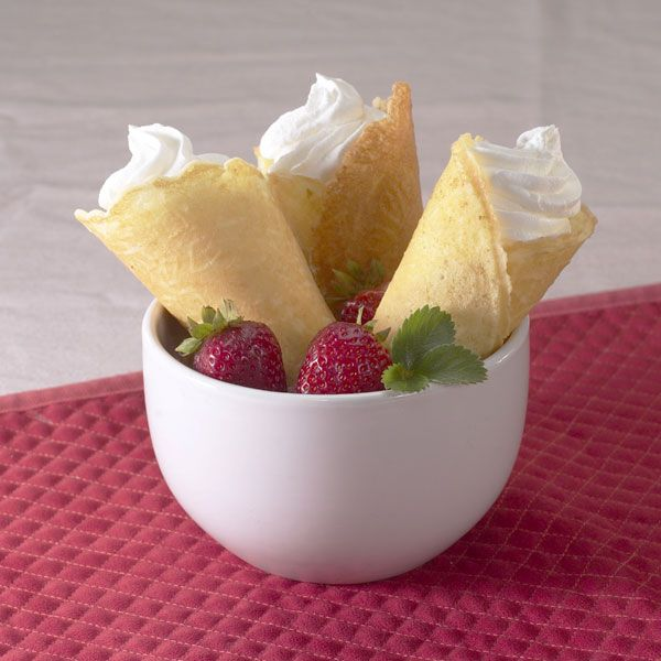 TheKrumkake (Krum kaka) is a traditional Scandinavian dessert cookie with a very delicate taste. Freshly out of the iron, it is hot and soft, and easy to roll into a cone. It quickly cools, and ha…