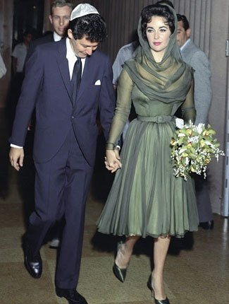 Wedding #4: Eddie Fisher, 1959-1964  The black and white film star wasn't shy when it came to color. The emerald green tea-length gown Taylor donned for her wedding to singer Eddie Fisher is a reminder that Taylor was one of the best dressed women of the century.