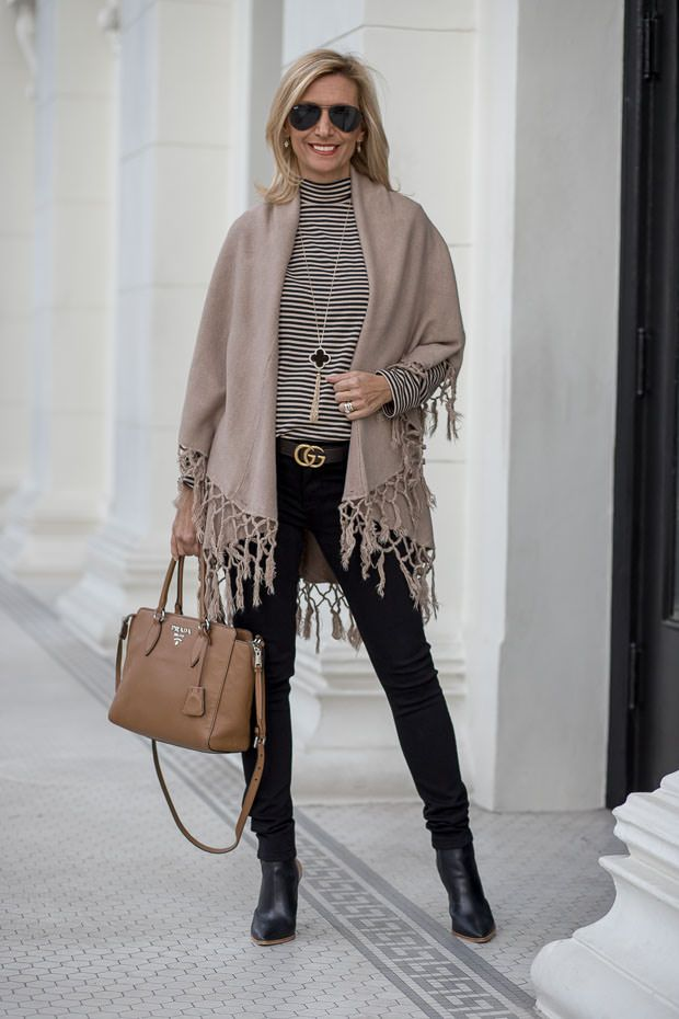 """Casual Yet Chic In Taupe And Black On my blog today """"casual yet chic in taupe and black"""" featuring our black moto jacket, stripe mock neck top, cape vest with fringe and a clover necklace. All available in our shop <a href="""