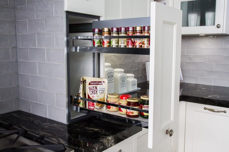 Traditional kitchen. On bench pull-out pantry. Spice rack. www.thekitchendesigncentre.com.au