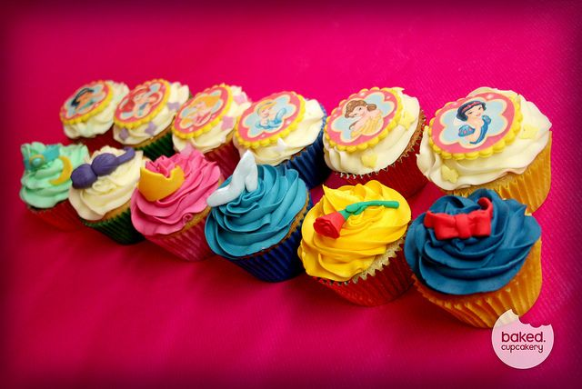 Disney Princess Cupcakes might be a cute favor. Then they could take some cake home with them too :)