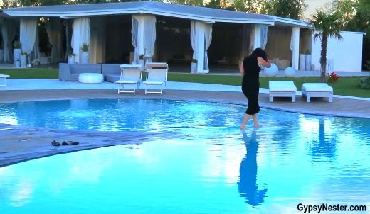 The pool, after a good day's bike ride, feels so miraculous, Veronica walks on water at Hotel Borgo Pantano in Sicily, Italy. With @vbtvacations