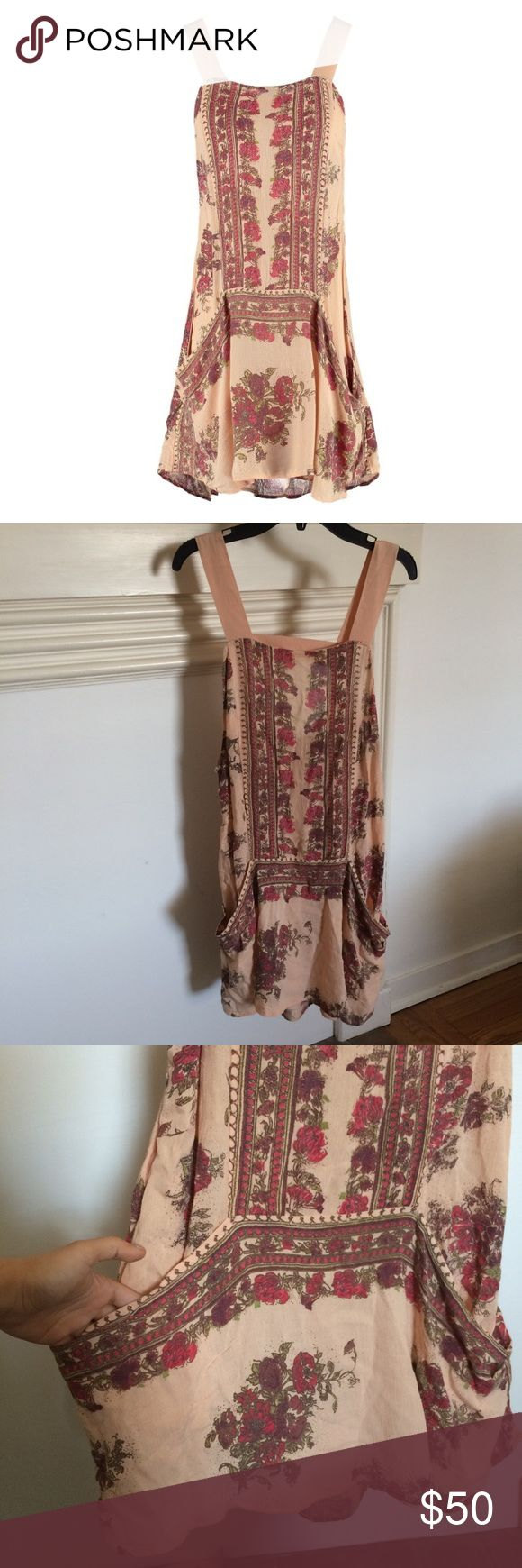 """NWT free people """"paradise song"""" dress Beautiful free people antique combo day dress. Has two pockets and an open back with thick straps. Perfect for spring or summer! Retails for $98. Size small Free People Dresses Mini"""