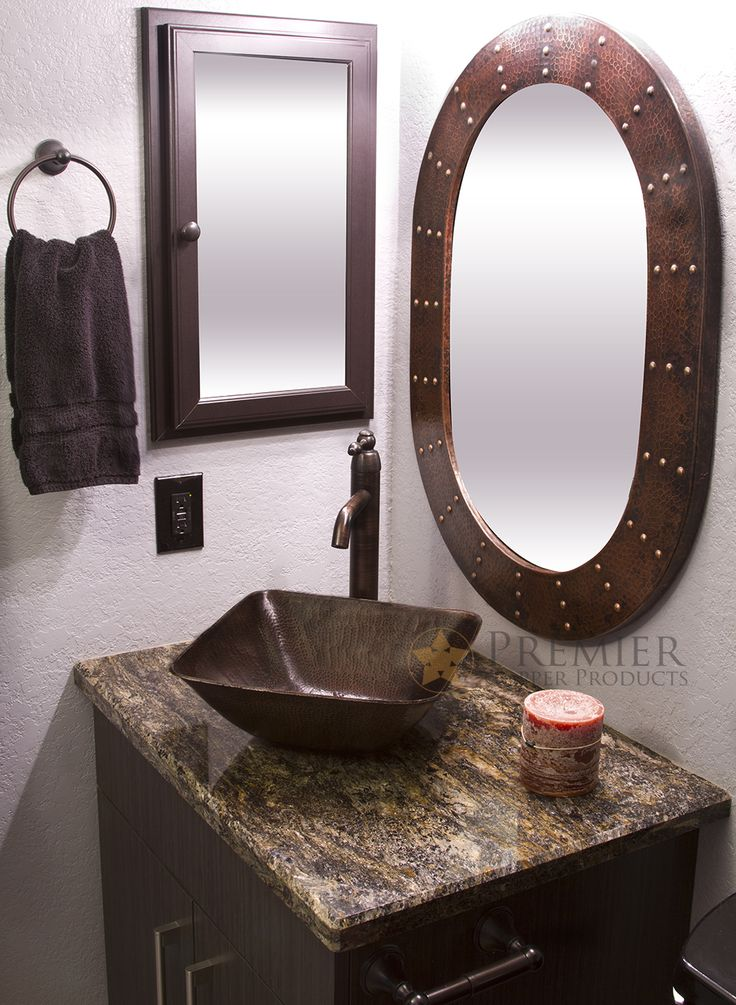 the square vessel hammered copper sink pairs perfectly with our hand hammered oval copper mirror with