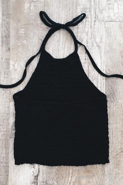 Our best selling quality halter top is back! Black colored halter top features self-tie neck and open back. Top is semi cropped (below the belly button) and has