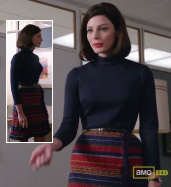 Megan Draper's striped wrap skirt and navy turtleneck on Mad Men.  Outfit Details: http://wornontv.net/5520/