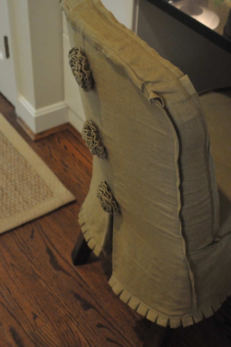 slipcover details - flat welt trim and mini pleated skirt + fabric flower accents