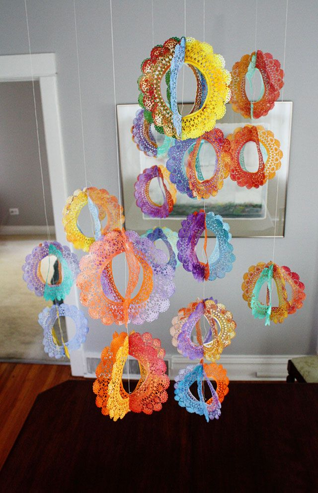 <3 <3 <3 ! ! ! Aunt Peaches: 3$ Rainbow Doily Spinners - do in wedding colors for bridal shower or leave white & add a little glitter which would look great in candlelight!