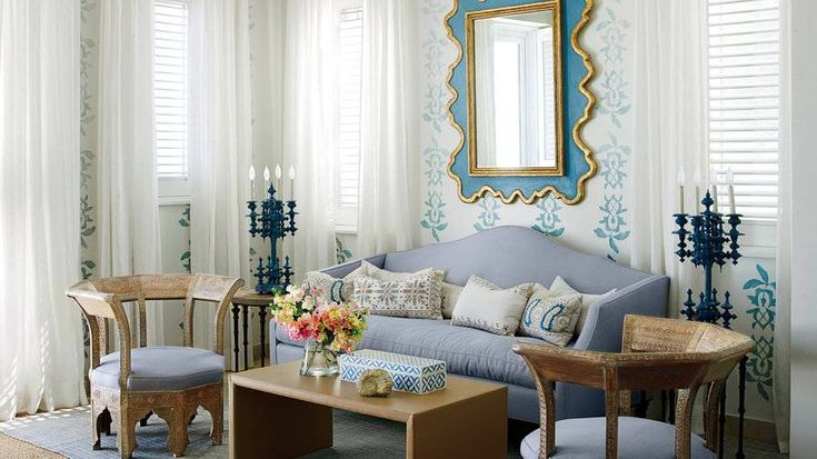 """Luu bypassed overhead lighting in most rooms in favor of antique lamps, like vintage candelabras (left), and plaster wall sconces handcrafted using local shells as molds (opposite). The ambient lighting dials up the romance of Luu's soft pastel palette. """""""