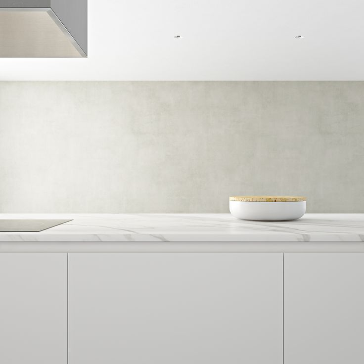 Dada Kitchens, Hi Line 6 display by Linee Studio. Minimalist kitchen in natural palette environment featuring earth-toned concrete walls.
