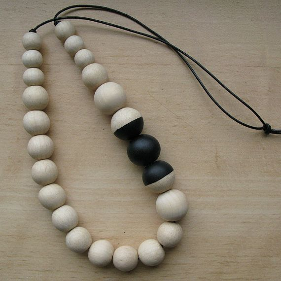 DETAILS:    • Natural Wooden Beads - 15, 20, 25 & 30 mm  • Black Leather    The wooden beads strung on a leather cord    MEASURES: • Length: