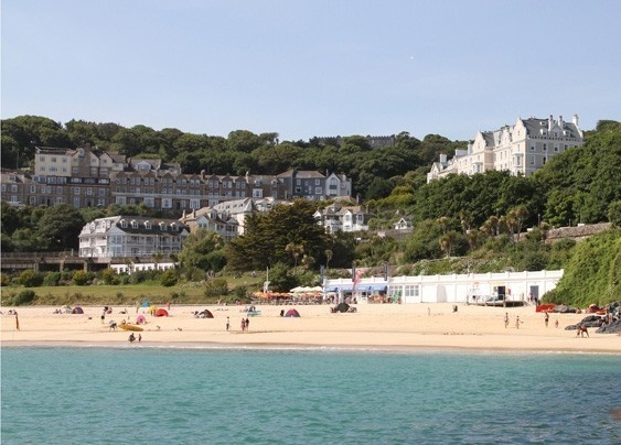 The Porthminster Hotel, St Ives (also known as St Ives Harbour Hotel). Great rooms, lovely outside area for your reception, and access down to the beach for your photography.