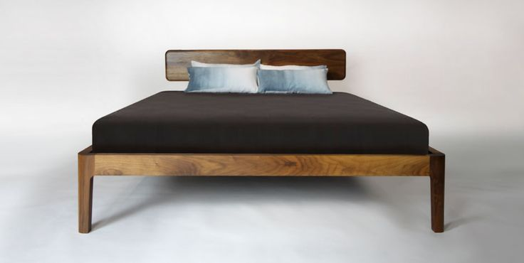Our Smooth Bed - solid walnut and immaculate craftsmanship adhere to the sleek design of this bed frame with headboard.