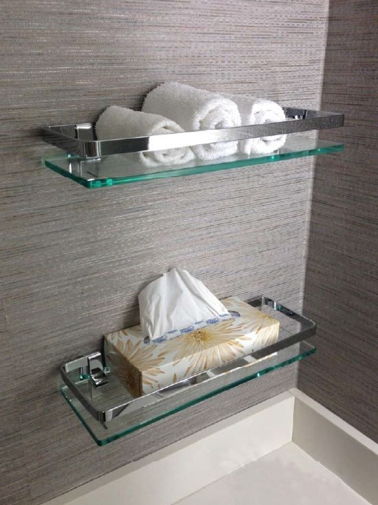 Glass shelf for bathroom wall.  Useful for displaying bath accessories and hand towels.