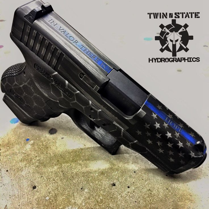 Glock we Cerakoted with the Thin Blue Line and subdued American flag. Laser engraving done by Black Sheep Arms.