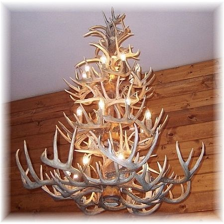 Hidalgo Antler Lighting - Whitetail Deer Antler Chandelier - 52 Antler, 24 Light  Bathe yourrustic furniture in thelight of a real antler lighting. If you have a large rustic cabin gathering or dining area for which you need an equally impressive piece of antler chandelier, behold this stunning three tier, 52 antler, 24 light chandelier.  The candles are made from natural antler pieces and all electrical wiring in this antler lighting is skillfully hidden within the antlers. Antlers are…