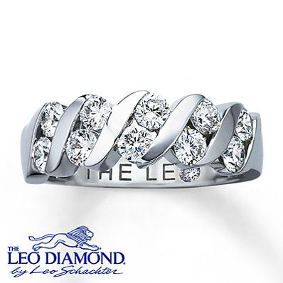 Ten round Leo diamonds are channel-set between sweeps of 14K white gold in this sensational ring for her. This Leo Diamond anniversary band is one carat total diamond weight. Independently Certified and laser-inscribed with a unique Gemscribe® serial number. The inside of the band features a round diamond within the Leo signature.