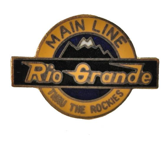 """RiO GRANDE Western RAiLROAD Main Line Thru the ROCKiES COLORADO State vintage lapel cloisonne enamel pin Train D&RGW by VintageTrafficUSA  24.00 USD  A vintage Rio Grande pin! Excellent condition. Measures: approx 1"""" Add inspiration to your handbag tie jacket backpack hat or wall. Have some individuality = some flair! 20 years old hard to find vintage high-quality cloisonne lapel/pin. Beautiful die struck metal pin with colored glass enamel filling…"""