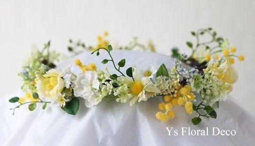 5月に二次会をなさった新婦さんのため、お作りさせていただいた花冠です。黄色のぽわぽわしたミモザをいれて、蔓の葉や小花をいれたナチュラルな風合いの花冠です。...