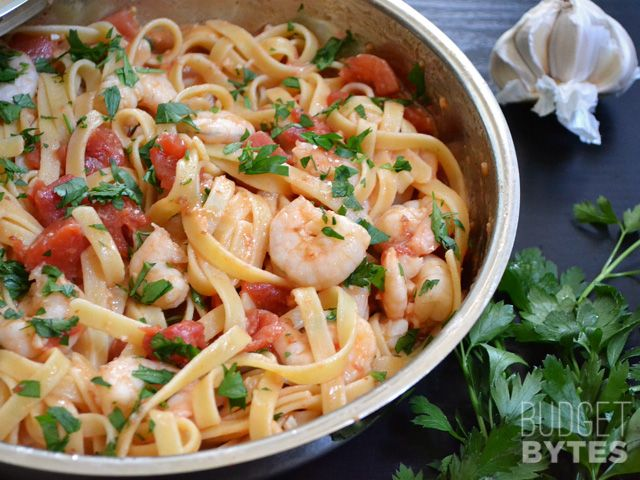 It takes less than 30 minutes to make this super flavorful and filling Spicy Tomato & Shrimp Pasta. Step by step photos.