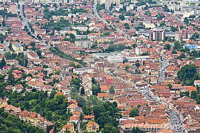 Aerial cityscape with road crossing the old center of Brasov, Romania
