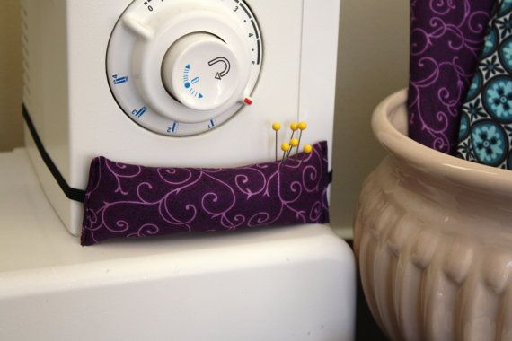 Pin cushion for your sewing machine. I sure need this.