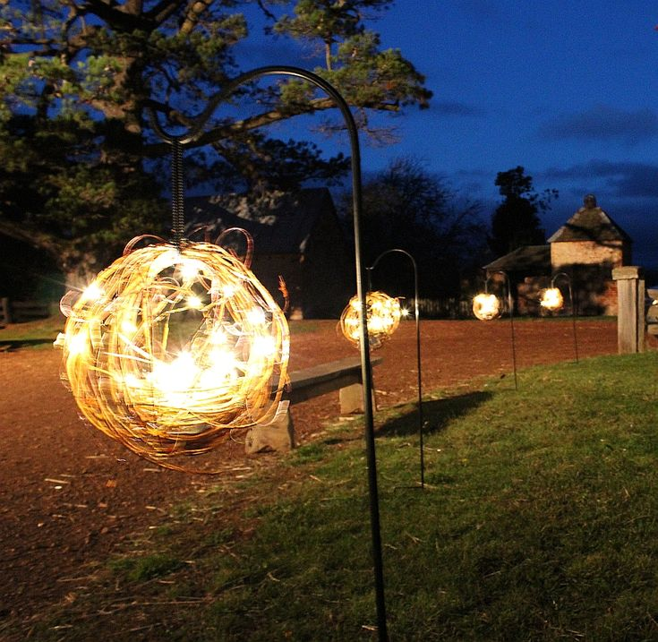 Barn wedding decorations. We custom made these gorgeous balls, complete with bird in a nest at the bottom and then hung them on shepherds hooks to light the path for guests attending the barn wedding. By Event Avenue