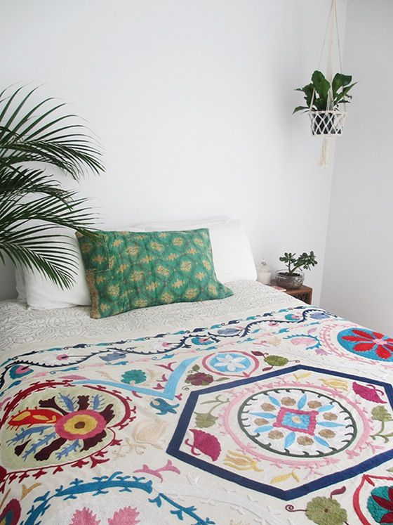 Create yourself a tropical Jungalow style bedroom with our Kantha Pillows and Suzani throws.