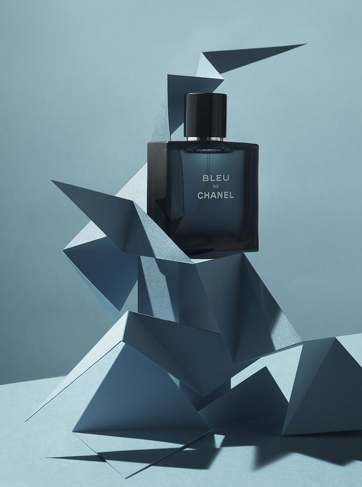 Bleu De Channel, graphical advertisement poster, attractively advertises the perfume, it's surreal composition and geometric origami is surreal and lures it's consumer in through it's fantasy and creation.