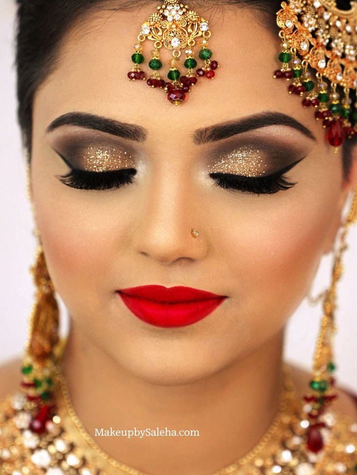 Bridal makeup for Barat gold smoky eye makeup and red lips MUA saleha abbasi