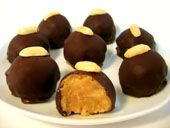 Cream Cheese Peanut Butter Balls are easy truffles made with cream cheese and peanut butter, and covered in melted chocolate.